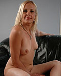 Leggy blonde mature babe in vinyl strips down.