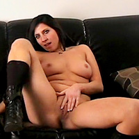 Stunning hot brunette enjoys masturbating her pussy in front of the camera