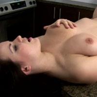 Brunette babe masturbating on the sink
